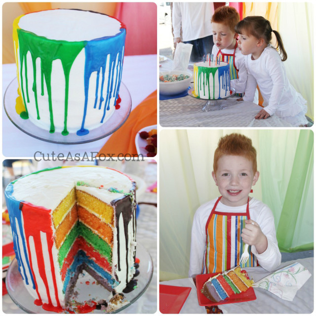 Rainbow Cake - 6 layers of colorful cake with paint drips going down the side.
