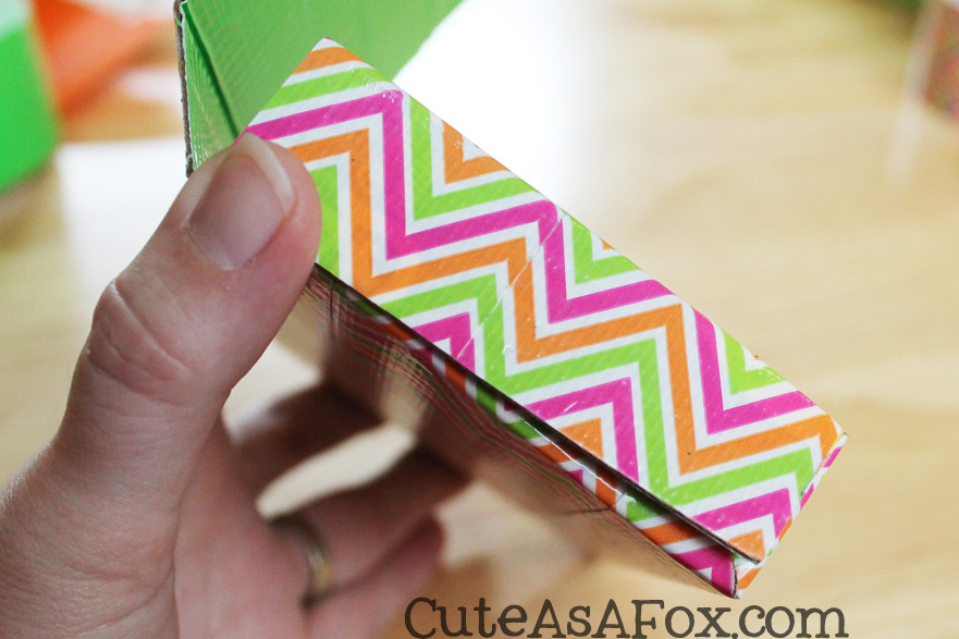 Assemble the holder by folding in all the scored lines. Secure the sides with additional pieces of Duck Tape®. Here is what the side looks like folded up.